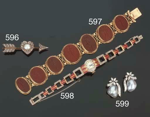 Orologio in oro, diamanti e ru