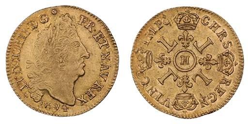 Louis XIV, Louis d'or aux quat