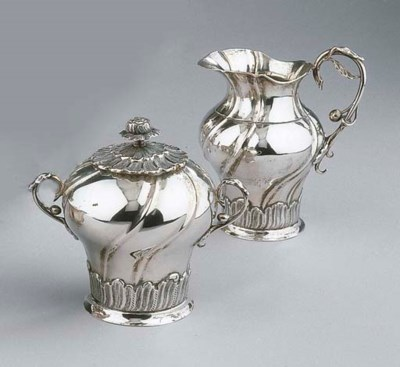 A Dutch silver milk jug and su