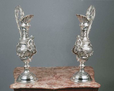 A pair of large silver jugs