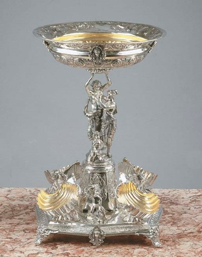 A large silver-gilt centre pie