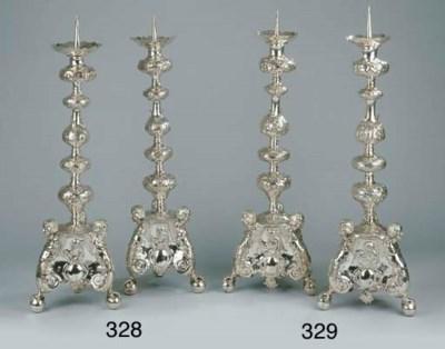 A pair of Dutch silver pricket