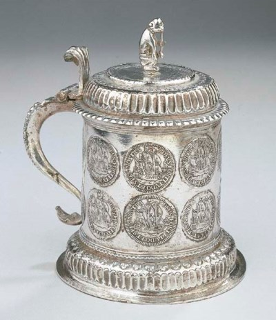 A Dutch silver coin tankard