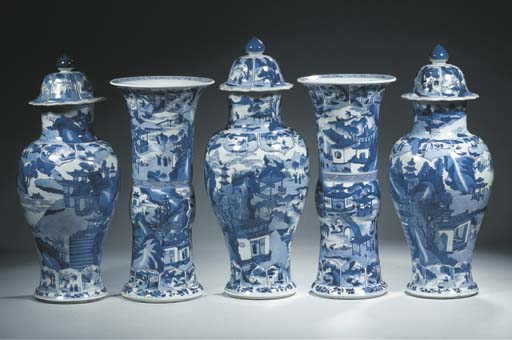 A blue and white five piece ga