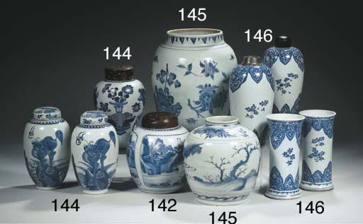 Four blue and white vases