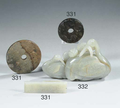 A group of seven jade objects