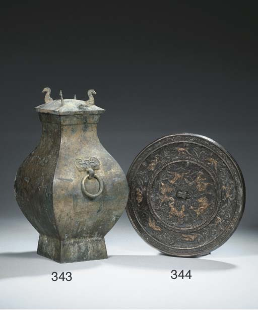 An archaic bronze vessel and c
