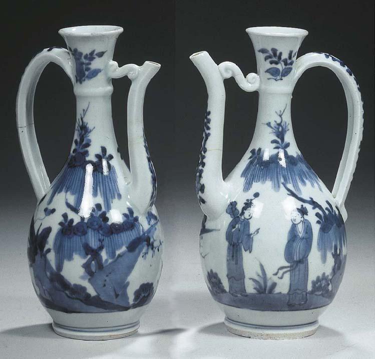 Two Arita blue and white ewers