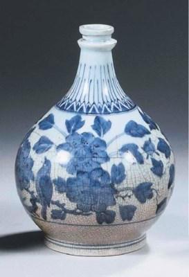 An Arita blue and white apothe