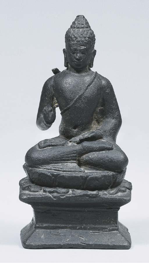 a javanese bronze figure of bu