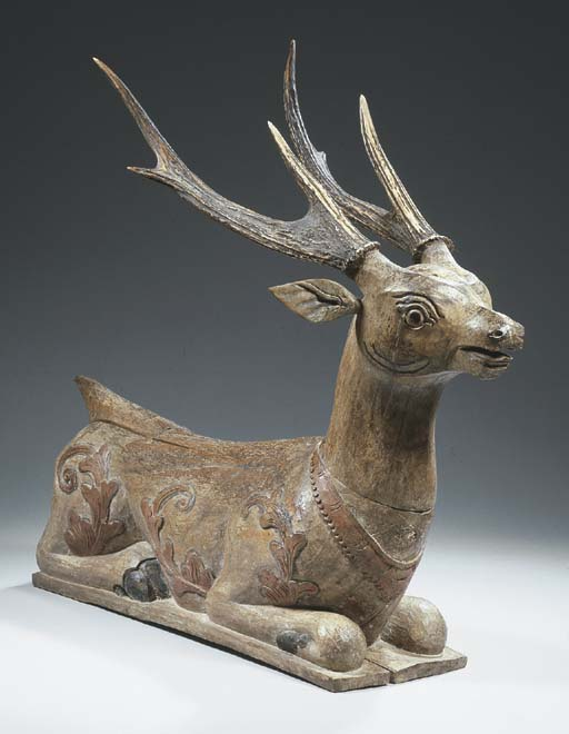 a balinese wood stag