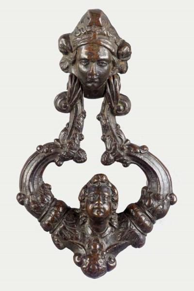 A bronze door knocker