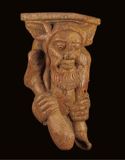 A carved wood architectural el