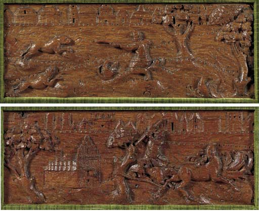 A pair of carved oak relief cu