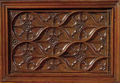 A carved wood relief panel
