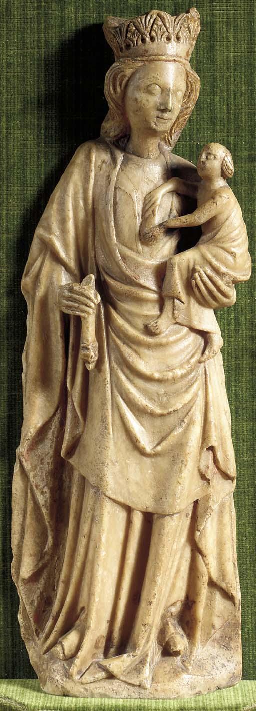 A parcel-gilt carved albaster