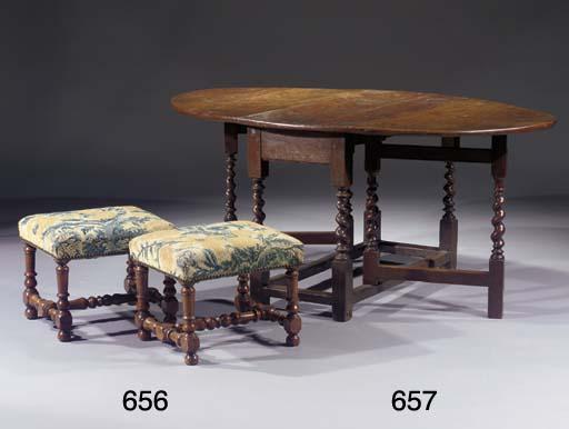 A pair of walnut stools