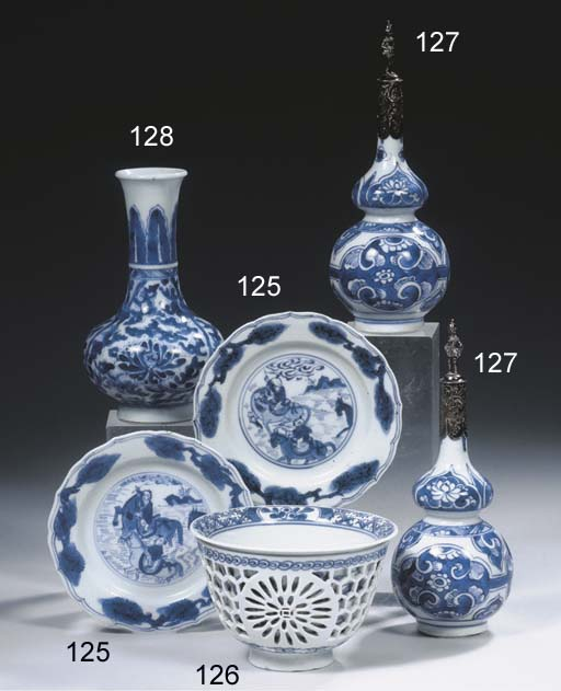 A pair of blue and white silve