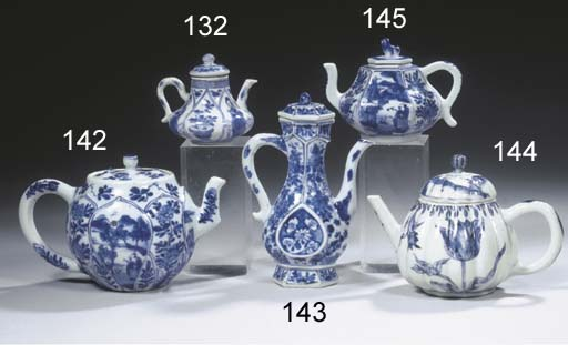 A small blue and white teapot