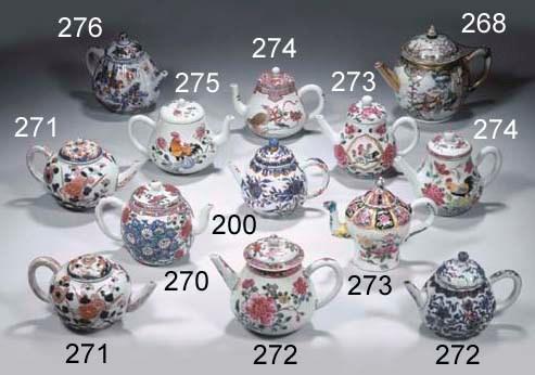 Three polychrome teapots and c