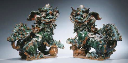 A pair of enamelled figures of