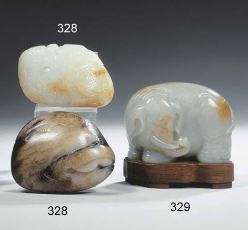 A pale celadon jade figure of