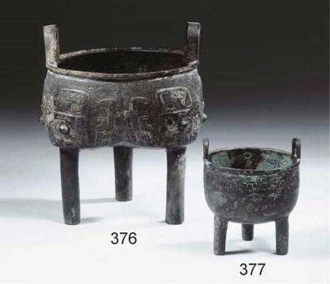 A small archaic bronze tripod