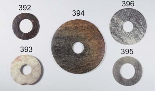A large Neolithic jade disc, b