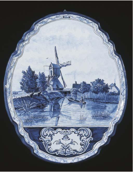 A Makkum Delftware blue and white landscape plaque