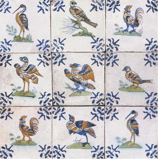 A Gouda polychrome ornithological tile panel
