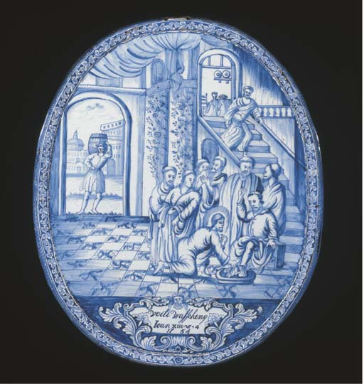 An Amsterdam Delftware dated blue and white oval biblical plaque