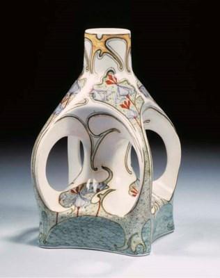 A glazed pottery four-handled