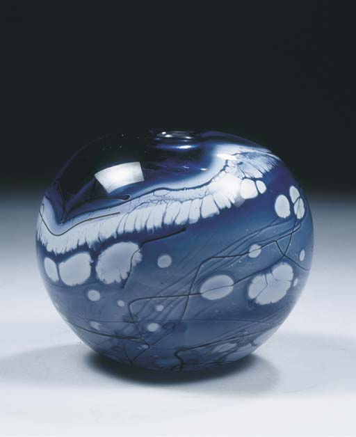 A blue, white and clear glass vase