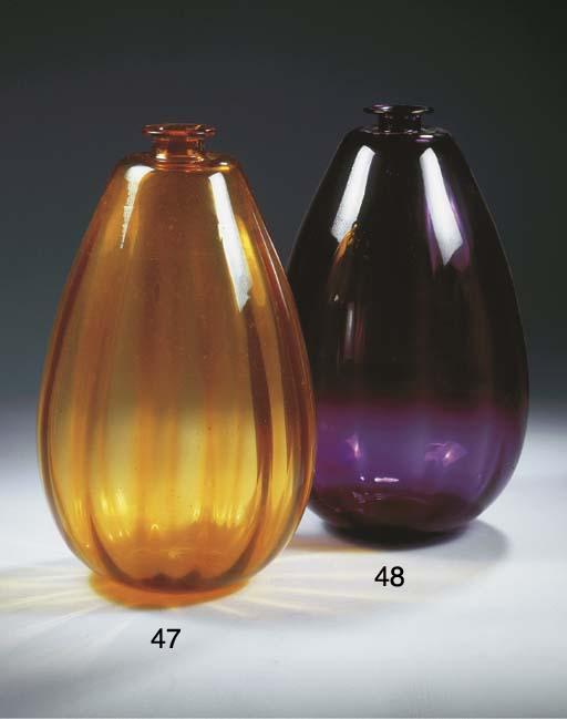 A large purple glass vase