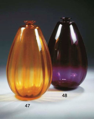 A large purple glass vase