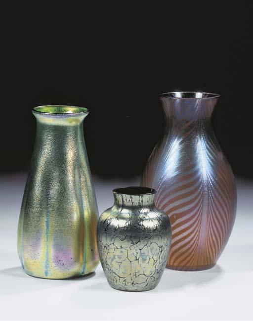 Three iridescent glass vases