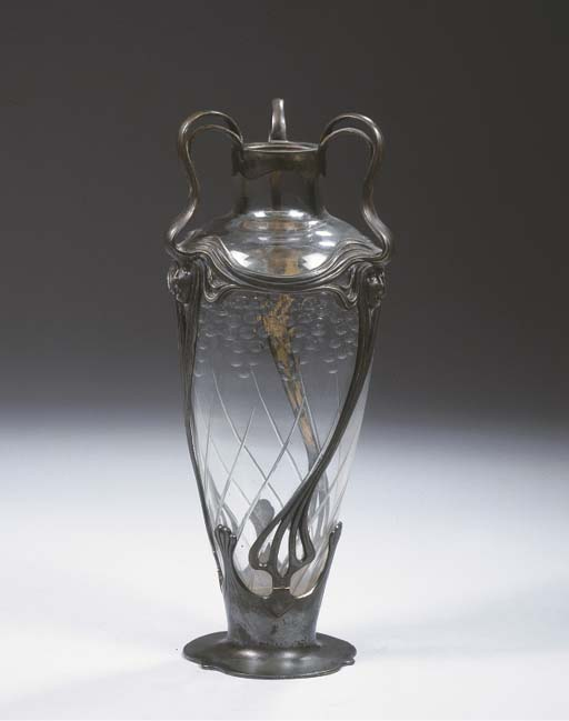 A glass and metal vase