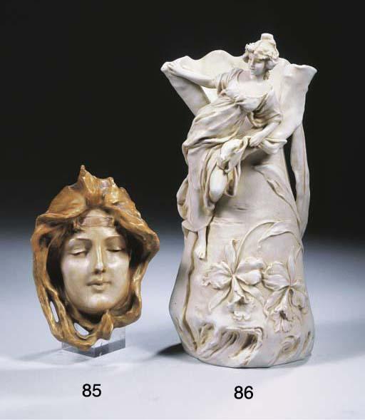 A glazed porcelain mask
