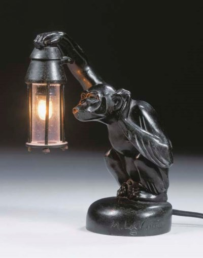 A green patinated table lamp