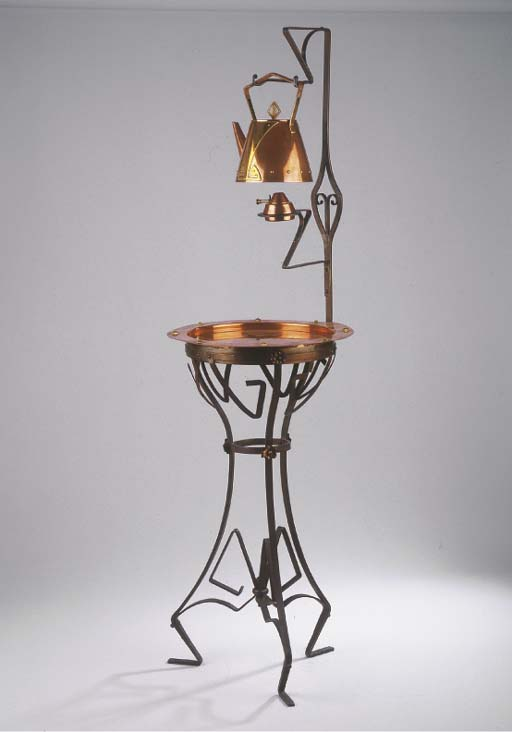 A copper, brass and cast iron kettle and stand