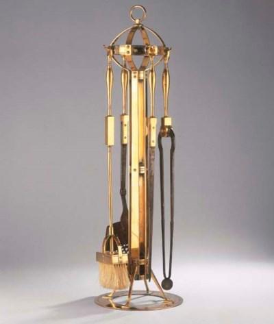 A set of brass fire-irons