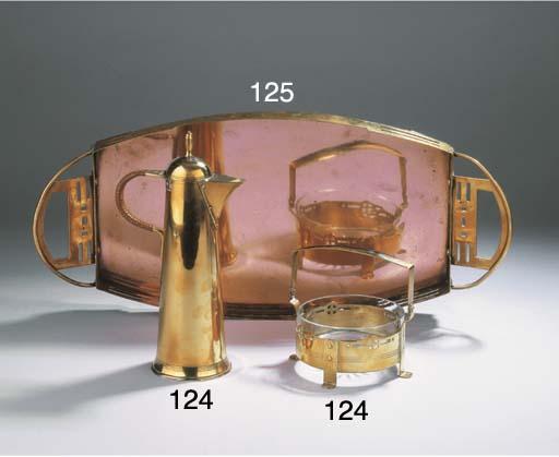 A brass coffee pot