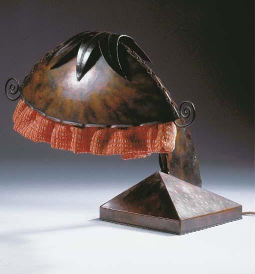 A patinated copper desk lamp