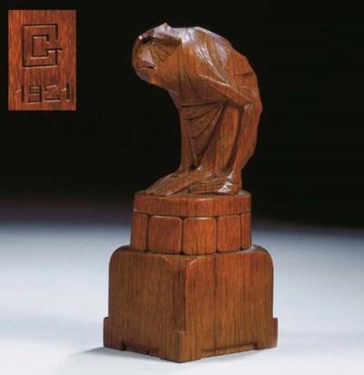 An oak figure of a sitting mon