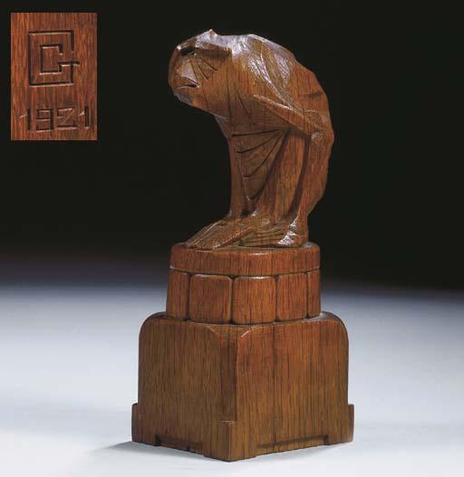 An oak figure of a sitting monkey