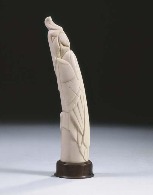 An ivory figure of a parakeet