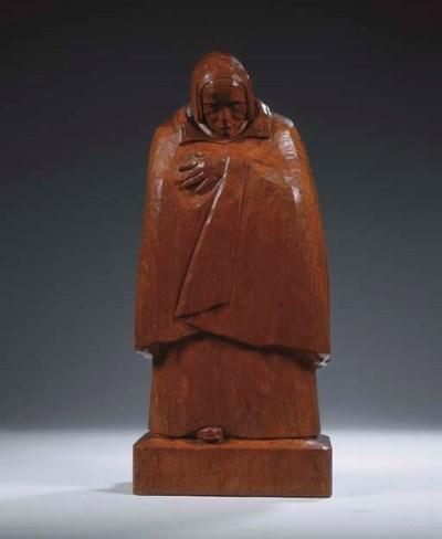 A carved oak figure of a fishe