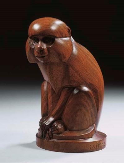A wooden figure of a monkey