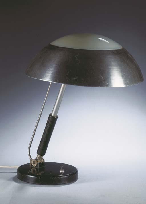 An aluminium and glass desk la