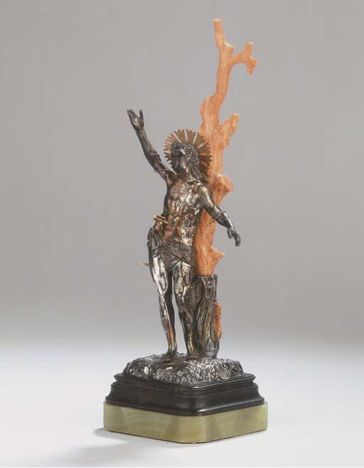 A fine silver and coral statue